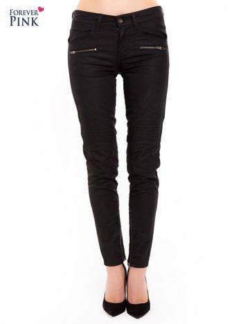 Czarne spodnie z suwakami przy nogawkach i po bokach