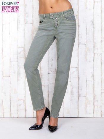Zielone strechowe spodnie z koronką przy kieszeni