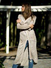 Beżowy ażurowany sweter z kieszeniami