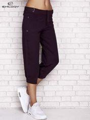 Ciemnofioletowe spodnie dresowe capri z wszytymi kieszeniami