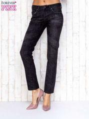 Czarne przecierane spodnie jeansowe ze srebrną nitką