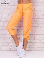 Fluopomarańczowe spodnie sportowe capri z wiązaniem