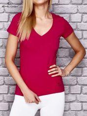 Różowy damski t-shirt sportowy z modelującymi przeszyciami