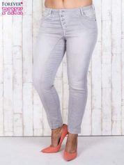 Szare jeansowe spodnie slim z przetarciami PLUS SIZE