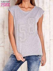 Szary t-shirt z numerem 58 z dżetów