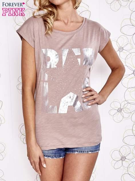 Beżowy t-shirt z motywem gwiazdy i dżetami