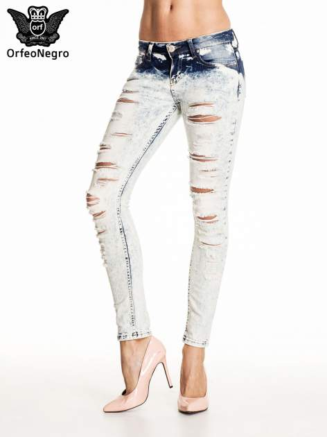 Błękitne marmurkowe spodnie trash jeans