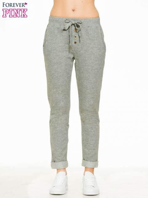 Ciemnoszare spodnie dresowe z guzikami wiązane w pasie