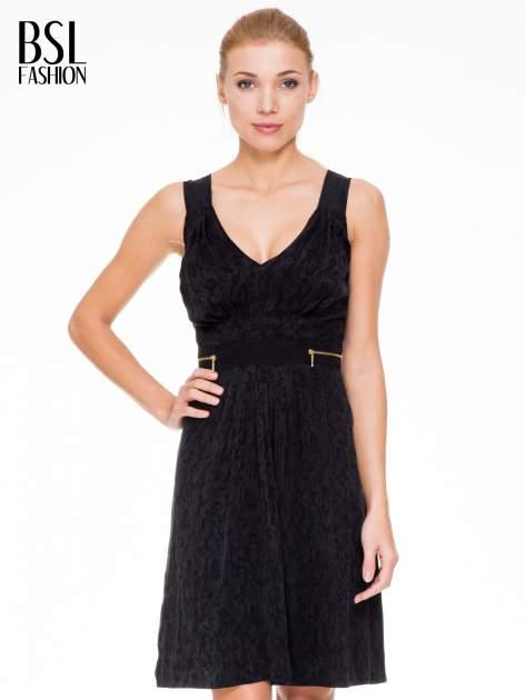 Czarna wzorzysta sukienka z suwakami