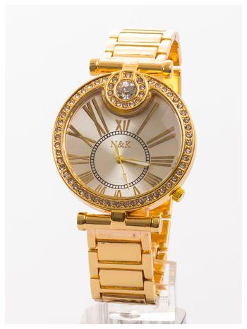 Damski złoty zegarek na bransolecie. Duża, ozdobna tarcza. Cyrkonie.