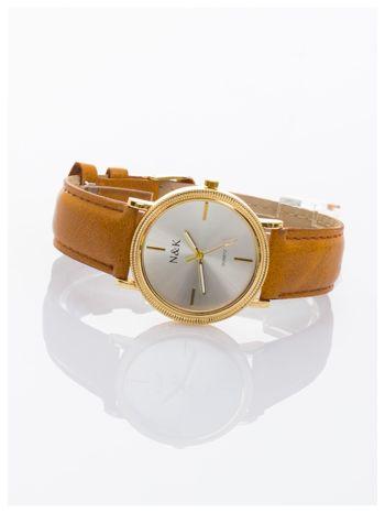 Klasyczny damski zegarek z elegancką i czytelną tarczą. Brązowy skórzany pasek. Ozdobna koperta