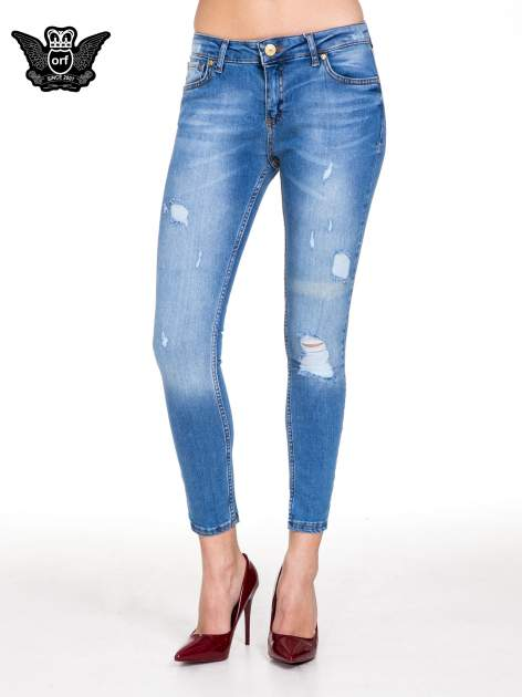 Niebieskie spodnie jeansowe z cieniowaną nogawką z przetarciami