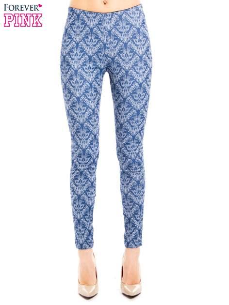 Niebieskie spodnie typu legginsy w ornamentowy wzór