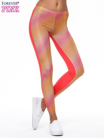 Pomarańczowe legginsy we fluorescencyjne wzory