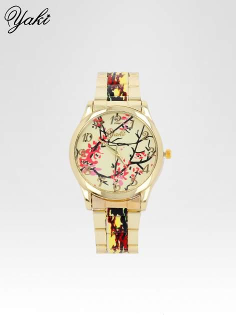 Złoty zegarek damski na bransolecie z motywem roślinnym