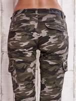 Moro spodnie z kieszeniami na nogawkach
