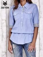 Niebieska koszula ze ściągaczem na dole