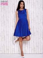 Niebieska rozkloszowana sukienka w groszki
