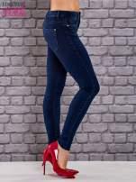 Niebieskie jeansowe spodnie skinny jeans z kieszeniami