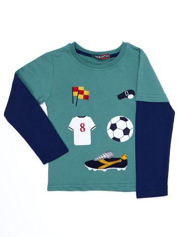 Bawełniana zielona bluzka dziecięca ze sportowymi naszywkami