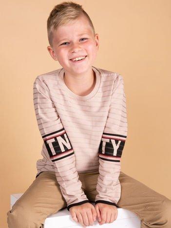 Beżowa bluzka dziecięca z nadrukiem na rękawach