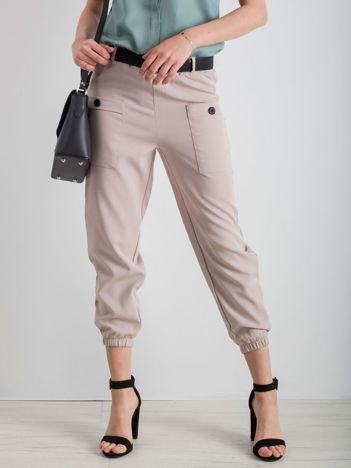 Beżowe spodnie ze ściągaczami