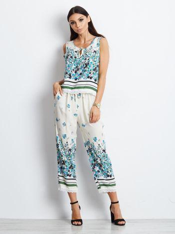 Beżowy komplet w kwiaty top i spodnie