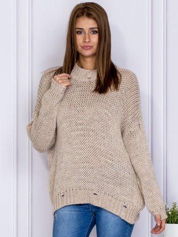 Beżowy sweter z ażurowaniem