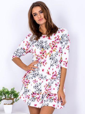 Biała sukienka z motywem roślinnym z falbankami