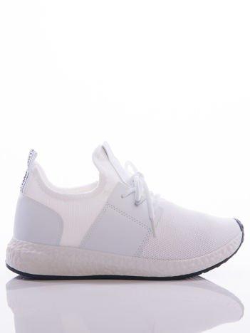 Białe półażurowe buty sportowe na białej sprężystej podeszwie