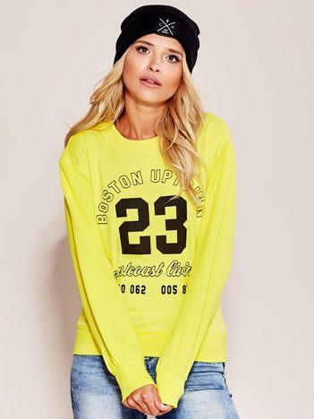 Bluza damska z napisem i wycięciem z tyłu żółta