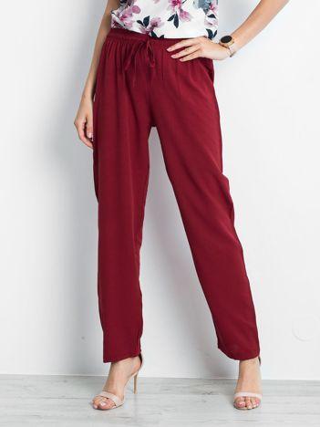 Bordowe spodnie Inability