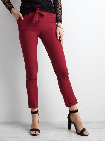 b3c57c785e7a Bordowe spodnie z wiązaniem