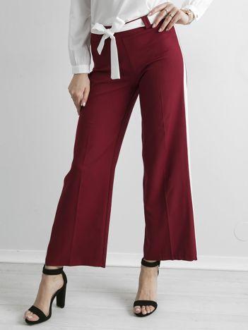 Bordowe szerokie spodnie z lampasami