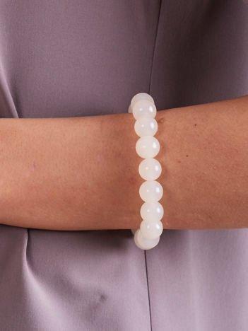 Bransoletka damska na gumce z białymi perełkami