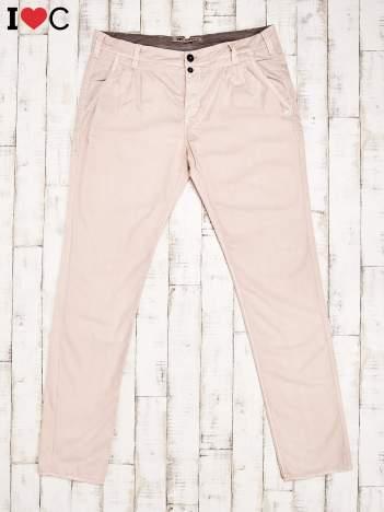 Brzoskwiniowe spodnie męskie