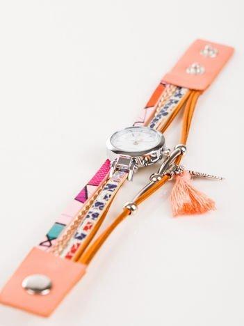 Brzoskwiniowy zegarek damski  z zawieszkami chwost i skrzydło