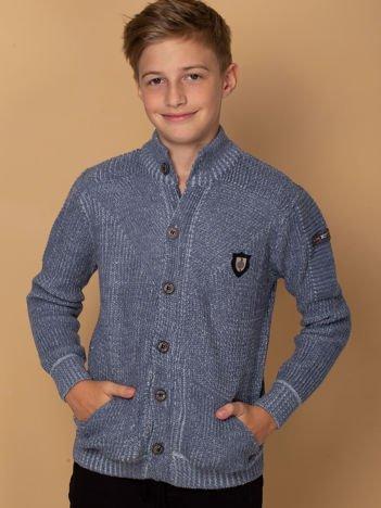 Ciemnoniebieski sweter dla chłopca z kieszeniami