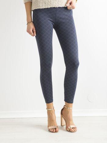 Ciemnoniebieskie legginsy w geometryczny wzorek