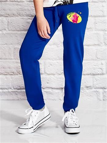 Ciemnoniebieskie spodnie dresowe dla dziewczynki z bajkowym motywem