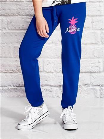 Ciemnoniebieskie spodnie dresowe dla dziewczynki z napisem NIEZŁY ANANAS