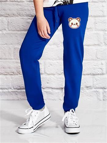 Ciemnoniebieskie spodnie dresowe dla dziewczynki z pandą
