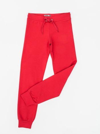 Ciemnoróżowe dresowe spodnie dziecięce z troczkami