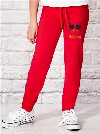 Ciemnoróżowe spodnie dresowe dla dziewczynki z motywem kota