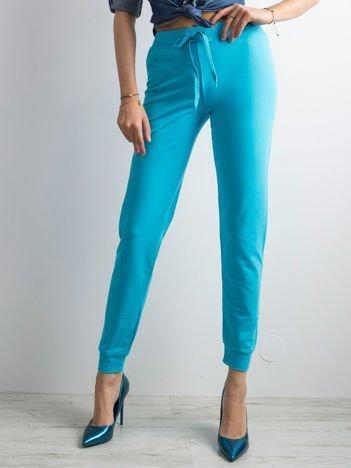 Ciemnoturkusowe spodnie dresowe z troczkami