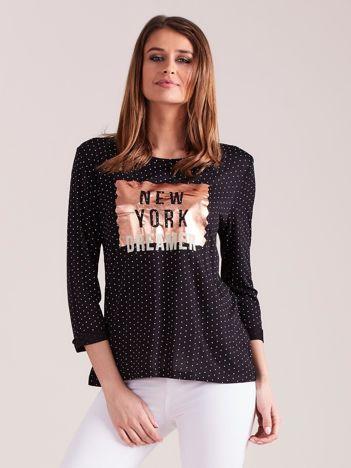 Czarna bluzka w groszki z aplikacją