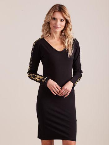 Czarna dopasowana sukienka z dekoltem V i cekinami