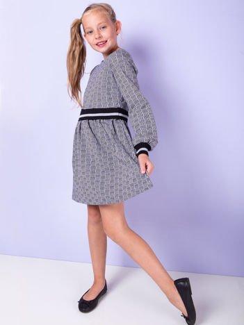 Czarna sukienka we wzory dla dziewczynki