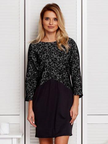 Czarna sukienka z ozdobną górą