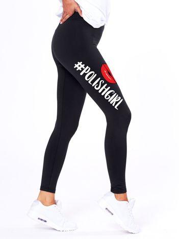 Czarne legginsy z nadrukiem na udzie
